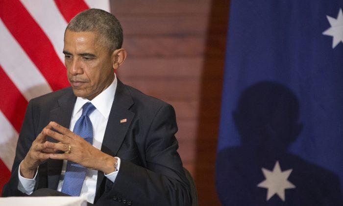 U.S. President Barack Obama listens to Australian Prime Minister Tony Abbott speak during a bilateral meeting in Beijing on Monday. (AP Photo/Pablo Martinez Monsivais)