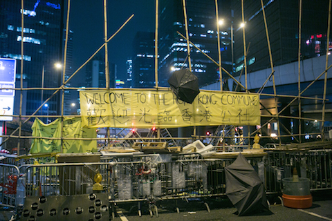 A makeshift barricade made by protesters is on the outskirts of the main protest site in the Central District of Hong Kong on Nov. 11, 2014. Over the past two nights protesters have been adding more and more materials to the barricades making them larger and wider.  (Benjamin Chasteen/Epoch Times)