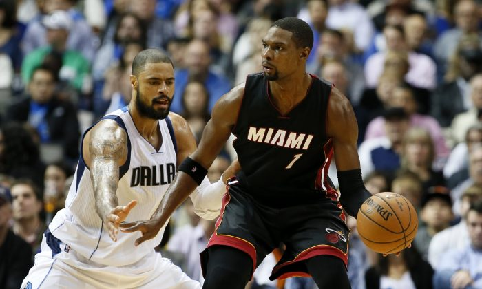 Dallas Mavericks' Tyson Chandler (6) defends as Miami Heat's Chris Bosh (1) attempts to move to the basket in an NBA basketball game, Sunday, Nov. 9, 2014, in Dallas. (AP Photo/Tony Gutierrez)