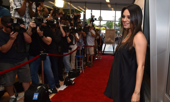 """Mila Kunis arrives at Los Angeles Premiere of """"Third Person"""" on Monday, June 9, 2014, in Los Angeles. (Photo by John Shearer/Invision/AP)"""