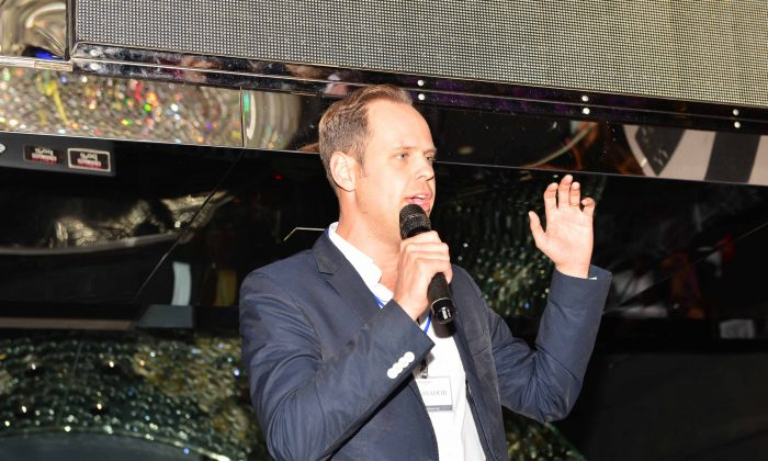 Malte Zeeck, Founder and CEO of the InterNations expatriate club addressing members at a meeting at the Magnum Club Hong Kong on Oct 30, 2014. (Bill Cox/Epoch Times)