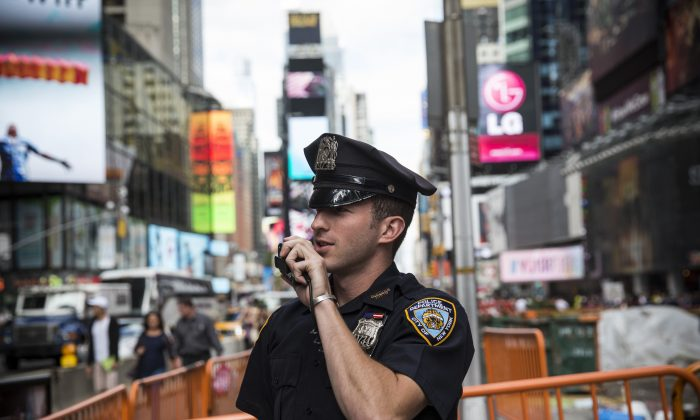 A New York Police Department (NYPD) officer speaks on his radio in Times Square on September 22, 2013 in New York City. (Andrew Burton/Getty Images)