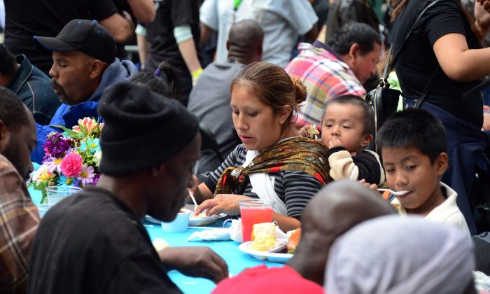 The homeless on Skid Row are seated for the annual Good Friday meal hosted by the LA Mission and served by volunteers and celebrities in Los Angeles on April 18, 2014. (Frederic J. Brown/AFP/Getty Images)