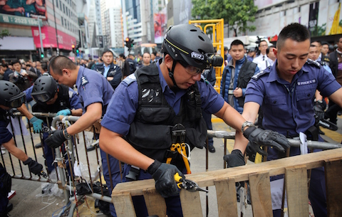 Police clear away the pro-democracy protest camp in the Causeway Bay district of Hong Kong on December 15, 2014. (Isaac Lawrence/AFP/Getty Images)