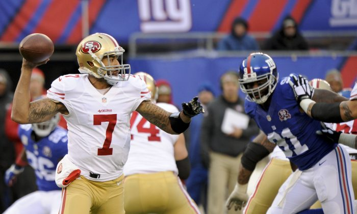 San Francisco 49ers quarterback Colin Kaepernick (7) throws a pass during the second half of an NFL football game against the New York Giants Sunday, Nov. 16, 2014, in East Rutherford, N.J.  (AP Photo/Bill Kostroun)