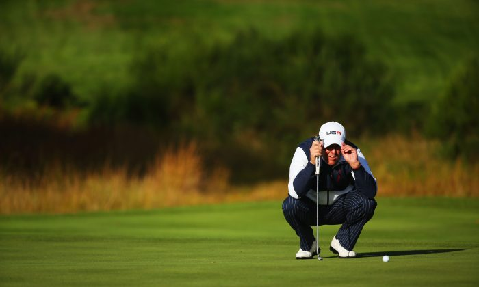 Phil Mickelson lines up a putt on the sixth green during the Morning Fourballs of the 2014 Ryder Cup on the PGA Centenary course at the Gleneagles Hotel on Sept. 26 in Auchterarder, Scotland. (Mike Ehrmann/Getty Images)