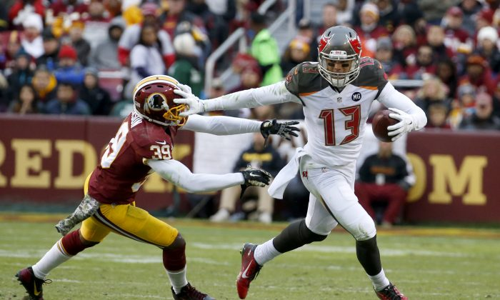 Tampa Bay Buccaneers wide receiver Mike Evans (13) pushes Washington Redskins cornerback David Amerson (39) away during the second half of an NFL football game in Landover, Md., Sunday, Nov. 16, 2014. (AP Photo/Alex Brandon)