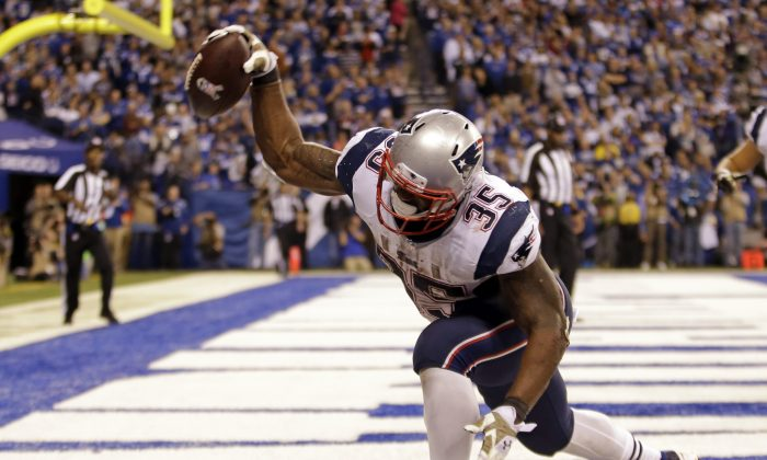New England Patriots running back Jonas Gray celebrates a touchdown against the Indianapolis Colts during the second half of an NFL football game in Indianapolis, Sunday, Nov. 16, 2014. (AP Photo/AJ Mast)