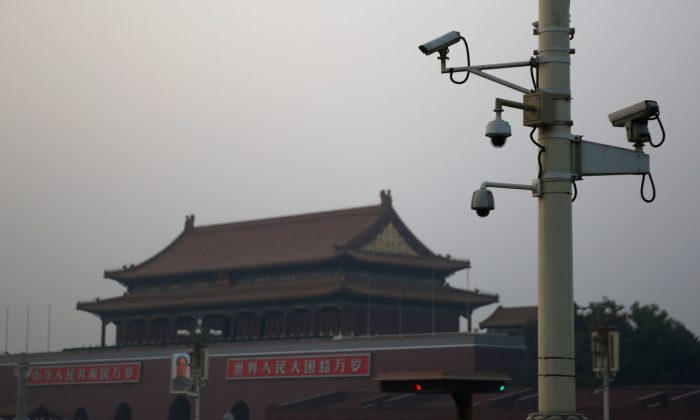 """Security cameras in front of the Tiananmen Gate on November 8, 2013 in Beijing, China. Because of the US$3.26 billion program """"Big Intelligence,"""" cameras like these are ubiquitous in China's big cities. (Feng Li/Getty Images)"""
