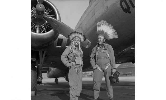 Gus Palmer (Kiowa, L), side gunner, and Horace Poolaw (Kiowa), aerial photographer, in front of a B-17 Flying Fortress. MacDill Field, Tampa, Fla., ca. 1944. (Estate of Horace Poolaw)