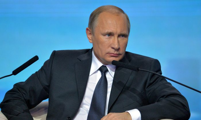 Russian President Vladimir Putin attends a meeting with members of the All-Russia Popular Front in Moscow, Russia, Tuesday, Nov. 18, 2014. (AP Photo/RIA-Novosti, Alexei Druzhinin, Presidential Press Service)