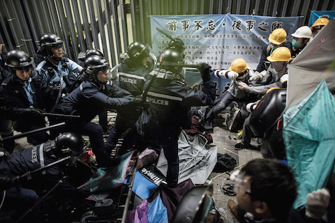 Police officers disperse pro-democracy protesters outside the Legislative Council building after clashes with pro-democracy activists on November 19, 2014 in Hong Kong. (Lam Yik Fei/Getty Images)