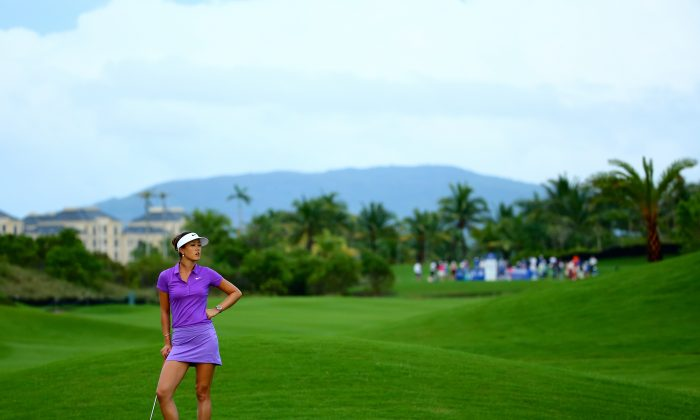 Michelle Wie in action during day four of the 2014 Blue Bay LPGA at Jian Lake Blue Bay Golf Course on Oct 26 in Hainan Island, China. (CFP/Getty Images)