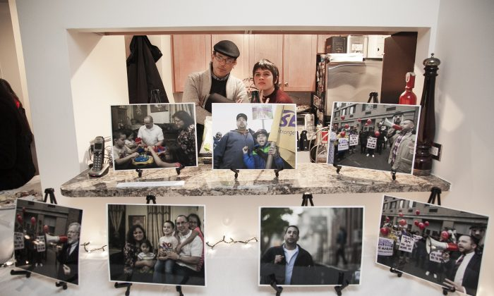 People at a pop-up exhibit on the lives of building workers in Chelsea, hosted at Lowell Kern's apartment at 520 W 23rd Street, on Nov. 18, 2014. (Samira Bouaou/Epoch Times)