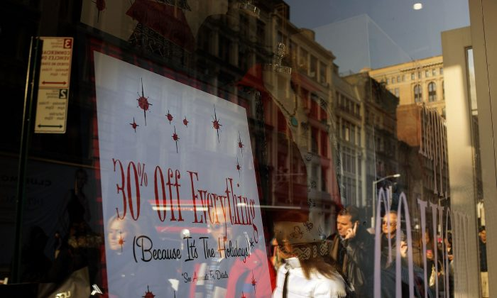 People shop along Broadway on Dec. 2, 2013, in New York City. According to the National Retail Federation, retail spending over the Thanksgiving weekend fell for the first time in at least seven years. (Spencer Platt/Getty Images)