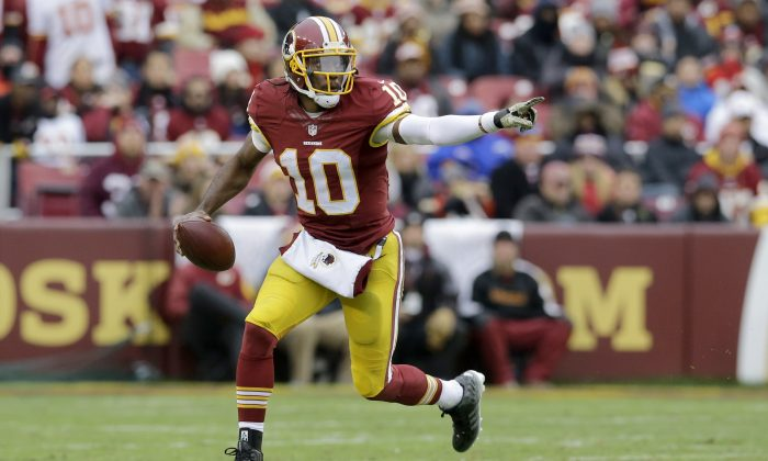 Washington Redskins quarterback Robert Griffin III (10) scrambles with the ball during the second half of an NFL football game against the Tampa Bay Buccaneers in Landover, Md., Sunday, Nov. 16, 2014. (AP Photo/Patrick Semansky)