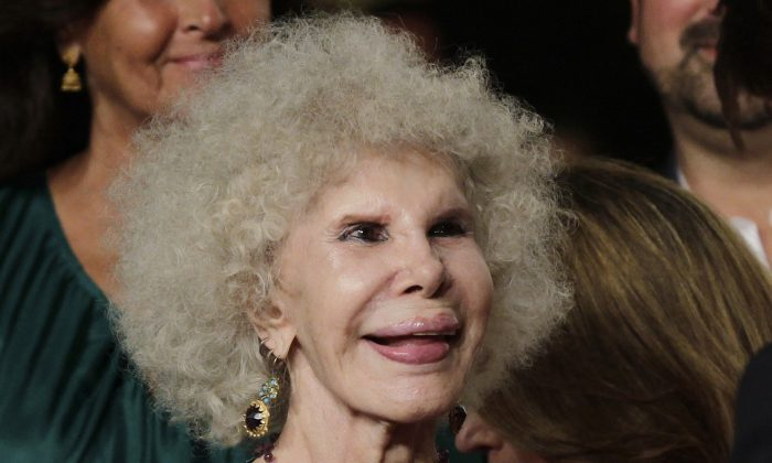 In this file photo taken June 16, 2010, Maria del Rosario Cayetana Alfonsa Victoria Eugenia Francisca Fitz-James Stuart y de Silva, the Duchess of Alba, arrives for a movie preview in Seville, Spain. The Duchess of Alba, one of Spain's wealthiest and most colorful aristocrats and listed as the world's most titled noble, has died at the age of 88. The Duchess died at her palatial home in the southern city of Seville on Thursday Nov. 20, 2014. The cause of death was not immediately made known. A relative of Winston Churchill the duchess shared toys with England's future Queen Elizabeth while living in England as a girl. (AP Photo/Toni Rodriguez, File)