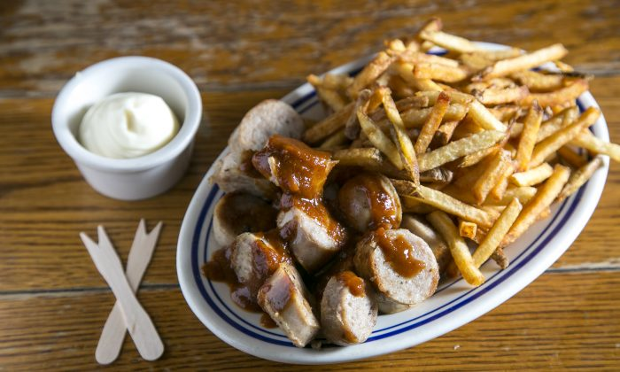 Currywurst with double-fried French fries. (Samira Bouaou/Epoch Times)