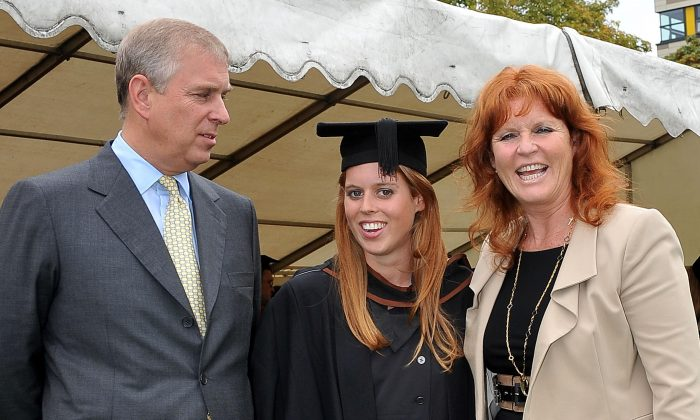 Britain's Prince Andrew, left, and Sarah, Duchess of York, right, pose together with their daughter, Princess Beatrice following her graduation ceremony at Goldsmiths College, London, Friday Sept. 9, 2011. (AP Photo/Ian Nicholson)