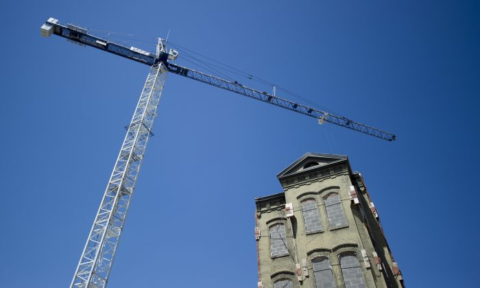 A giant crane stands near a historic building that is being incorporated into new construction in Washington, DC, on May 1, 2013. Affordable housing in the Washington, D.C. metropolitan area is turning into a real issue, according to an October Urban Institute report. (JIM WATSON/AFP/Getty Images)