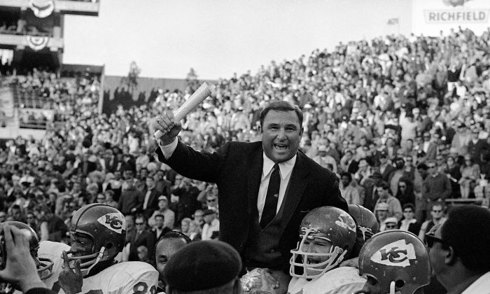 In this Jan. 4, 1970, file photo, Kansas City Chiefs coach Hank Stram is carried on the shoulders of his team after the Chiefs defeated Oakland Raiders 17-7 to win the American Football League title in Oakland, Calif. The flames have been rekindled in a once-great rivalry. The Chiefs and Raiders are fun and relevant again, playing for first place just like they did so many times in their colorful past. (AP Photo/File)