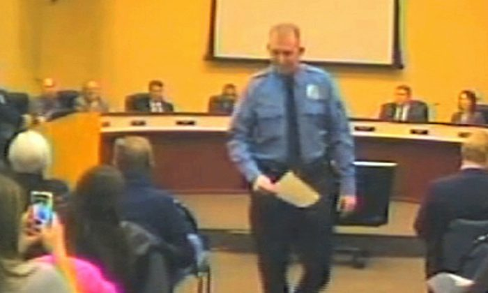 In this file Feb. 11, 2014 image from video released by the City of Ferguson, Mo., is officer Darren Wilson at a city council meeting in Ferguson. (AP Photo/City of Ferguson)