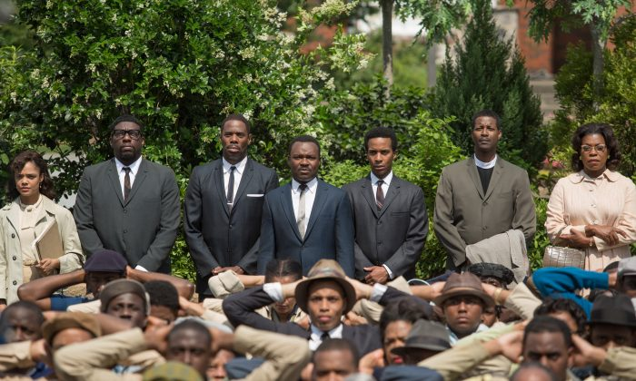 """This image released by Paramount Pictures shows, standing from left, Tessa Thompson, Omar Dorsey, Colman Domingo, David Oyelowo as Martin Luther King, Jr., André Holland, Corey Reynolds and Lorraine Toussaint in a scene from """"Selma."""" The film was nominated for five Spirit Awards on Tuesday, Nov. 25, 2014. Winners will be revealed at the annual awards ceremony on Feb. 21. 2015. The ceremony will air live from Santa Monica, Calif. on IFC. (AP Photo/Paramount Pictures, Atsushi Nishijima)"""
