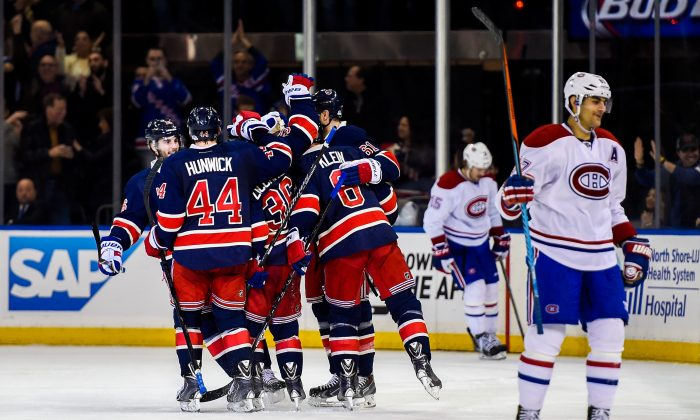 The New York Rangers celebrate a goal against the Montreal Canadiens at Madison Square Garden on Nov. 23, 2014 in New York City. Surprisingly, the regulation time loss by high-flying Montreal was its sixth by at least three goals this season. (Alex Goodlett/Getty Images)