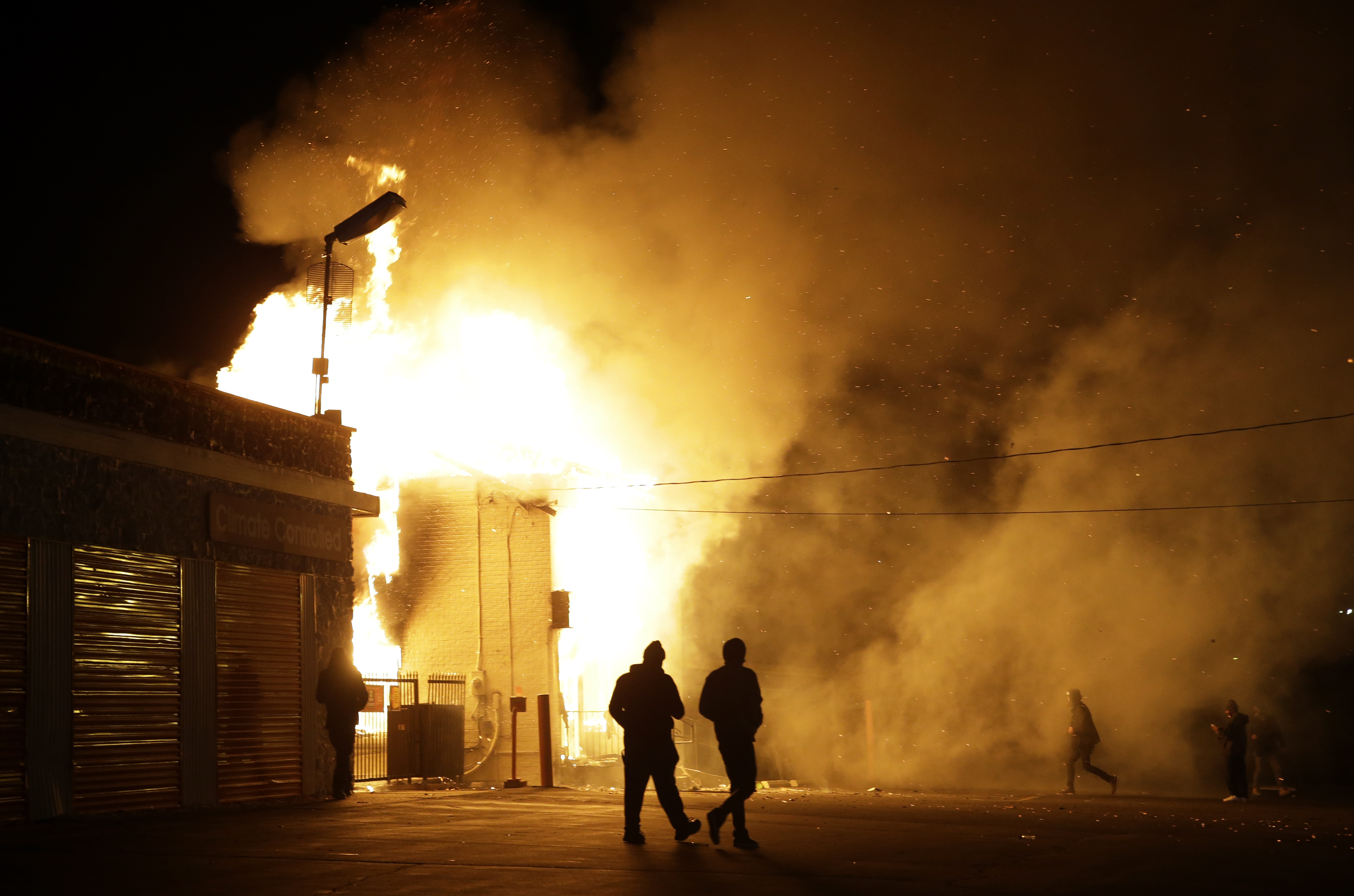 West Florissant Avenue in Ferguson, MO: Protestors Burn Buildings, Including The Original Red's BBQ
