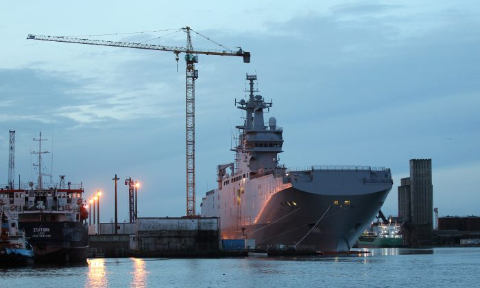 The Vladivostok Mistral-class helicopter carrier docking at Saint-Nazaire harbor, western France, on Nov.14, 2014.  (AP Photo/Laetitia Notarianni)