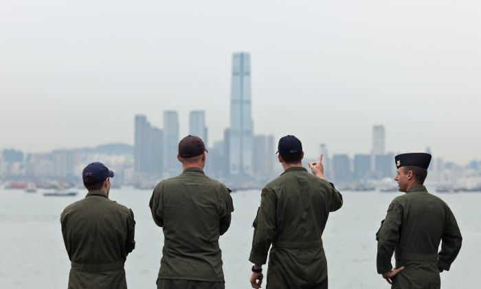 Navy personnel on board the USS Makin Island look towards the ICC building (C) in Hong Kong on Aug. 20, 2014. Michael Pillsbury, a top adviser to the Pentagon, says the US needs to rethink its analysis on China. (Anthony Wallace/AFP/Getty Images)
