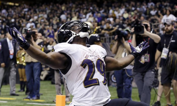 Baltimore Ravens running back Justin Forsett celebrates his touchdown carry in the second half of an NFL football game against the New Orleans Saints in New Orleans, Monday, Nov. 24, 2014. The Ravens won 34-27. (AP Photo/Jonathan Bachman)