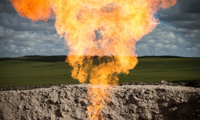 A gas flare is seen at an oil well site on July 26, 2013 outside Williston, North Dakota. (Andrew Burton/Getty Images)