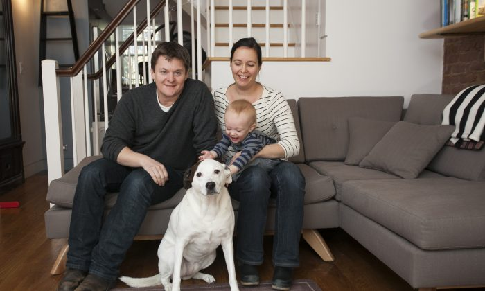 Architect Kyle Page, landscape architect Hardy Stecker, their son Otis Page, 11 months, and their dog Mazzy at their home in Clinton Hill, Brooklyn, on Nov. 21, 2014. (Samira Bouaou/Epoch Times)