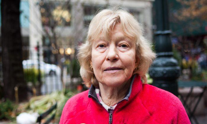 Eva-Lee Baird, retired art teacher currently with Grannies Peace Brigade, in Midtown Manhattan, NY, on Nov. 25, 2014. (Petr Svab/Epoch Times)