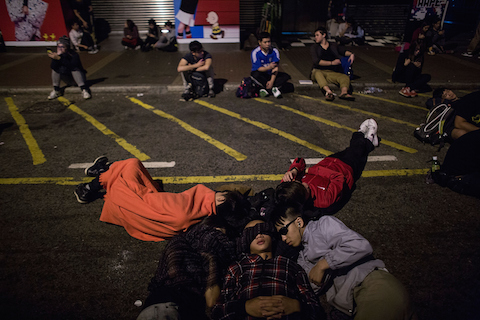 Pro-democracy protesters sleep on the Road in the Mong Kok district on November 27, 2014 in Hong Kong. (Lam Yik Fei/Getty Images)