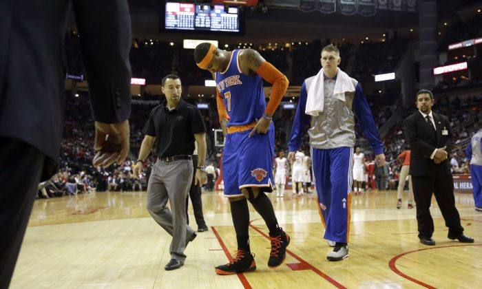 New York Knicks' Carmelo Anthony (7) leaves the court during the second quarter of an NBA basketball game against the Houston Rockets Monday, Nov. 24, 2014, in Houston. (AP Photo/David J. Phillip)