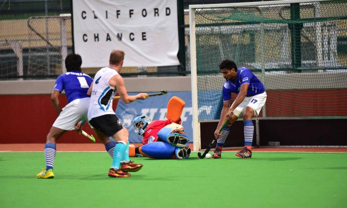 Punjab-A's number 17, Gagandeep Singh saves off the line during their 3-2 win in the Hong Kong Hockey Association Premier Division match against HKFC-A at Sports Road on Sunday Nov. 23, 2014. (Bill Cox/Epoch Times)