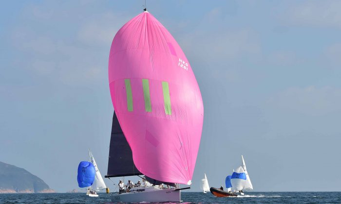'Mojito' winner of Races-4 & -5 on Day-2 of the UK Sailmakers Winter Saturday Series heading for the Leeward Mark in Port Shelter during Race-3 on Saturday Nov 22, 2014. (Bill Cox/Epoch Times)