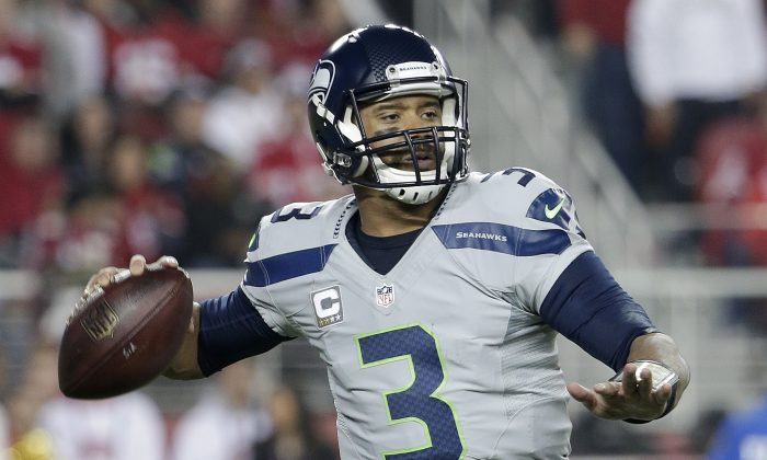 Seattle Seahawks quarterback Russell Wilson (3) passes against the San Francisco 49ers during the second quarter of an NFL football game in Santa Clara, Calif., Thursday, Nov. 27, 2014. (AP Photo/Marcio Jose Sanchez)