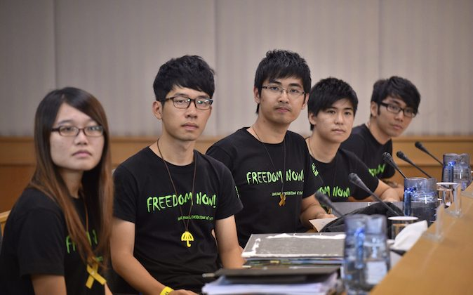 Leaders of the Hong Kong Federation of Students (L-R) Yvonne Leung, Nathan Law, Alex Chow, Lester Shum and Eason Chung arrive for talks with Hong Kong authorities, aimed at ending weeks of rallies, on the same day the city's leader ruled out democratic reforms, in Hong Kong on October 21, 2014. (Philippe Lopez/AFP/Getty Images)