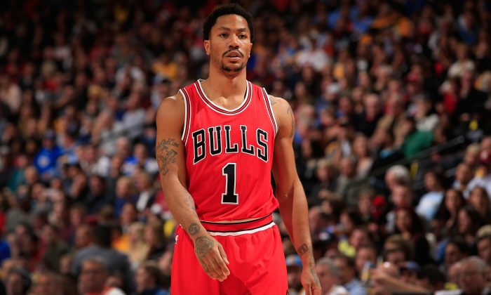 Derrick Rose #1 of the Chicago Bulls looks on during a break in the action against the Denver Nuggets at Pepsi Center on November 25, 2014 in Denver, Colorado. The Nuggets defeated the Bulls 114-109.