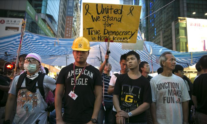 Pro-democracy protesters stand guard in Mong Kok, Kowloon Oct. 4 in Hong Kong. Victims of Communism Memorial Executive Director Marion Smith said Hong Kong should remind us of the nature of communism and the value of democracy. (Paula Bronstein/Getty Images)