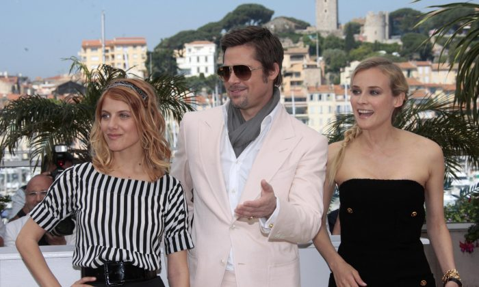 French actress Melanie Laurent (L), US actor Brad Pitt and German actress Diane Kruger pose during the photocall of the movie 'Inglourious Basterds' directed by Quentin Tarantino in competition at the 62nd Cannes Film Festival on May 20, 2009. (AFP/Getty Images)
