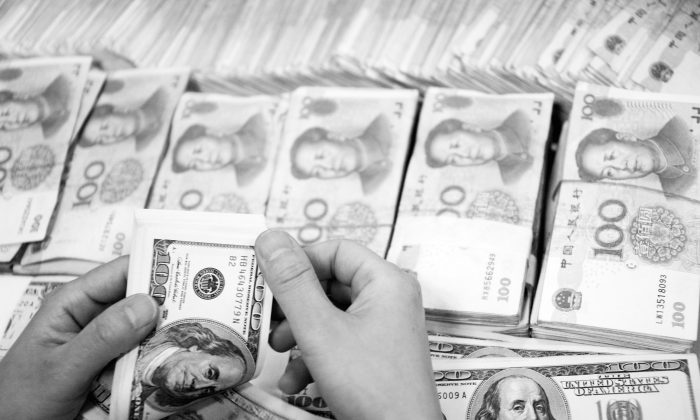 US$19.6 million cash and 27 Kg gold were seized from the home of a minor official who managed a state water company. The official is under investigation for corruption, China's state-run Xinhua News Agency reported. (ChinaFotoPress/Getty Images)