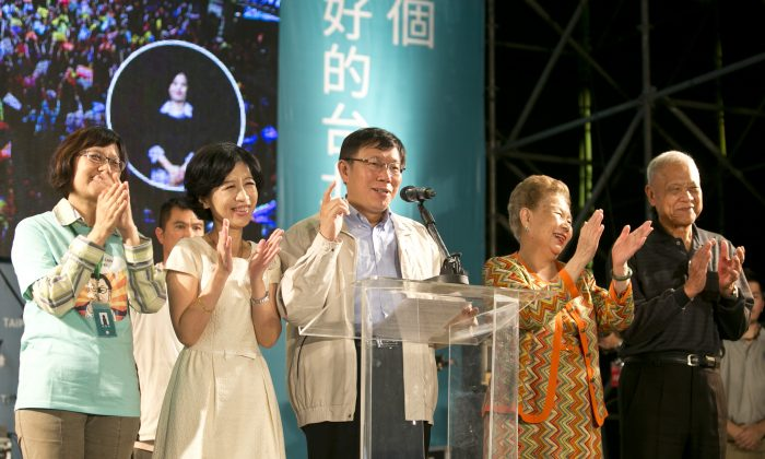 Independent Taipei mayor-elect Ko Wen-je celebrates his victory in the 2014 Taipei mayoral elections at his headquarters on Nov. 29, 2014, in Taipei, Taiwan. Millions of voters went to the polls for the island's largest ever local elections, as the Democratic Progressive Party defeated the ruling Nationalist Party in 16 out of 22 county elections. (Ashley Pon/Getty Images)