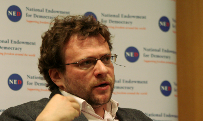 """Peter Pomerantsev, British author and documentary producer, co-authored a special report, """"The Menace of Unreality: How the Kremlin Weaponizes Information, Culture and Money."""" He introduced the report at the National Endowment for Democracy on Nov. 13. (Gary Feuerberg/Epoch Times)"""