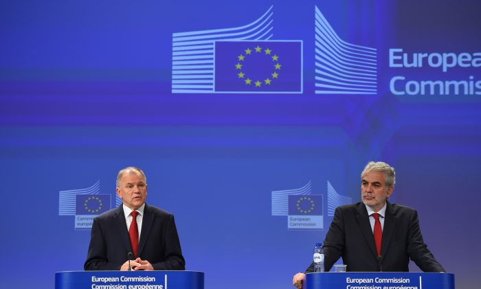 European Commissioner for Humanitarian Aid and Crisis Management and EU Ebola coordinator Christos Stylianides (R) and Commissioner for Health and Food Safety Vytenis Andriukaitis at the European Commission headquarters in Brussels, Belgium on Nov. 18, 2014 after visiting Ebola-affected area in Africa. (Emmanuel Dunand/AFP/Getty Images)