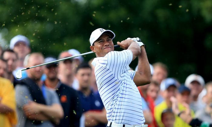 Tiger Woods hits his tee shot on the 13th hole during the second round of the 96th PGA Championship at Valhalla Golf Club on Aug. 8 in Louisville, Ky. (David Cannon/Getty Images)