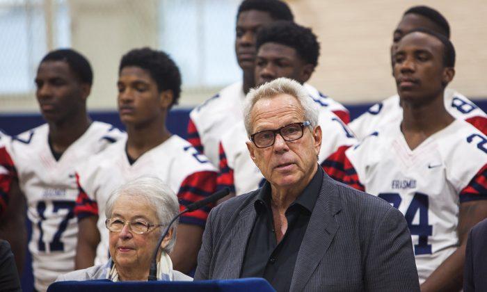 New York Giants chairman Steve Tisch announces his $1.2 million donation to New York City high school football at Erasmus Hall High School in Brooklyn, N.Y., on Dec. 2, 2014, while Schools Chancellor Carmen Fariña looks on. (Petr Svab/Epoch Times)